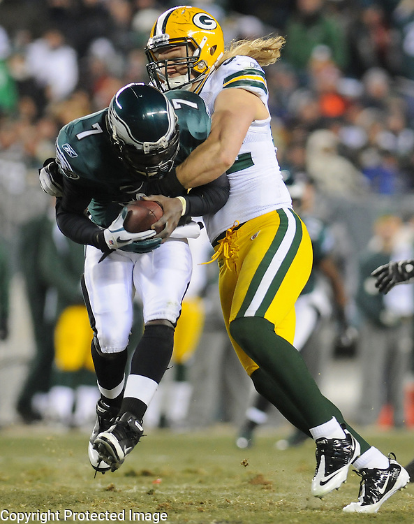 Green Bay Packers linebacker Clay Matthews hits Eagle quarterback Michael Vik for a sack against the Philadelphia Eagles during the second quarter of the Wild Card round playoff game at Lincoln Financial Field in Philadelphia, Penn., on Sunday, Jan. 9, 2011.
