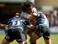 Photo: Richard Lane/Richard Lane Photography. Bath Rugby v London Wasps. Aviva Premiership. 21/04/2012. Wasps' Jonathan Poff  is tackled by Bath's David Wilson and Michael Claassens.