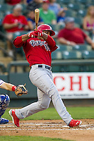 Memphis Redbirds outfielder Oscar Taveras #15 swings the bat during the Pacific Coast League baseball game against the Round Rock Express on April 24, 2014 at the Dell Diamond in Round Rock, Texas. The Express defeated the Redbirds 6-2. (Andrew Woolley/Four Seam Images)