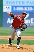 Joan Montero (49) of the Altoona Curve delivers a pitch during a game against the New Britian Rock Cats at New Britain Stadium on June 25, 2014 in New Britain, Connecticut.  New Britain defeated Altoona 3-1.  (Gregory Vasil/Four Seam Images)