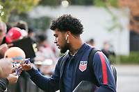 TORONTO, ON - OCTOBER 15: DeAndre Yedlin #2 of the United States signs autographs as he enters the stadium during a game between Canada and USMNT at BMO Field on October 15, 2019 in Toronto, Canada.