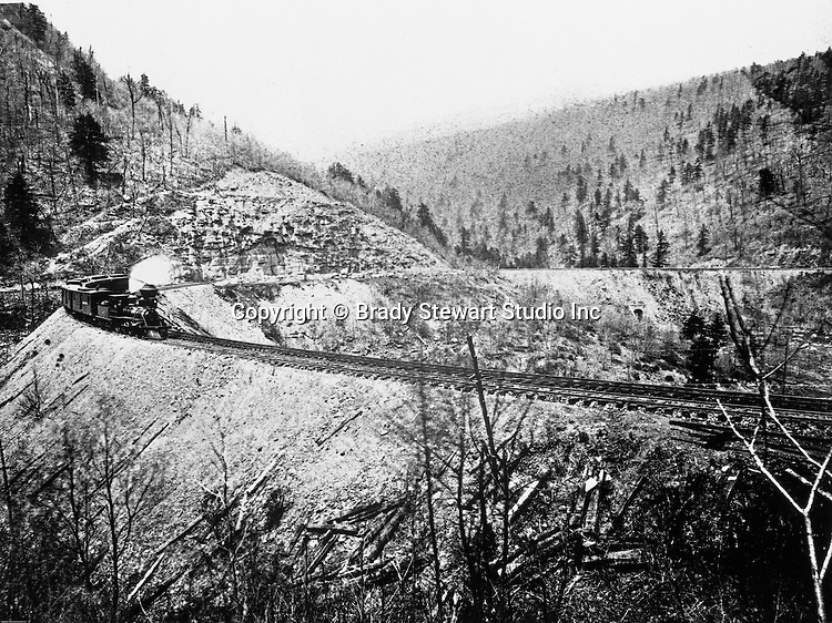 """Altoona PA:  Brady Stewart went to Altoona Pennsylvania during the winter of 1903 and took this photograph of the famous Horseshoe Curve.  Called an """"engineering marvel"""", it was completed in 1854 by the Pennsylvania Railroad. It was later used by Penn Central, then Conrail, and is currently owned and operated by the Norfolk Southern Railway."""