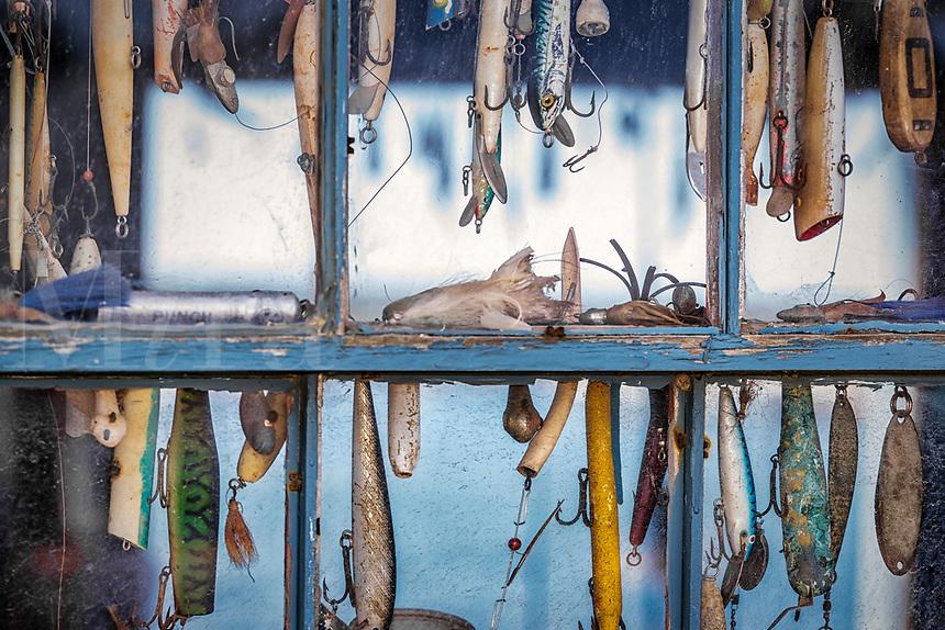 Hooks and lures in a fishing shack window, Menemsha, Cillmark, Martha's Vineyard, Massachusetts, USA.