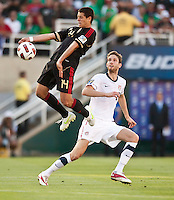 PASADENA, CA – June 25, 2011: Mexico player Javier Hernandez (14) and USA player Clarence Goodson (21) during the Gold Cup Final match between USA and Mexico at the Rose Bowl in Pasadena, California. Final score USA 2 and Mexico 4.