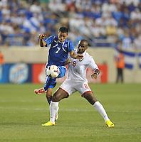 Darwin Ceren Delgado (7) of El Salvador goes against Khaleem Hyland (8) of Trinidad & Tobago.  Trinidad & Tobago tied El Salvador 1-1 in the first round of the Concacaf Gold Cup, at Red Bull Arena, Monday July 8 , 2013.
