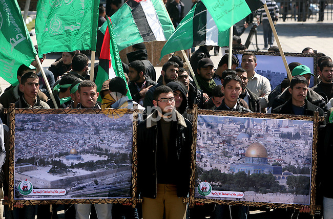 Palestinian students gather as they protest in Gaza City on February 27, 2012, two days following violence in the flashpoint Al-Aqsa mosque compound in Jerusalem's Old City, between Israeli forces and Palestinians. The unrest is believed to have been fuelled by web postings by Israeli rightists urging Jews to visit the mosque compound and assert Israeli sovereignty over the site, one of the most sensitive in the Middle East. Know to Muslims as Al-Haram Al-Sharif it considered the third holiest site in Islam, while it is known to Jews as the Temple Mount and is revered as Judaism's most sacred place. Photo by Ashraf Amra