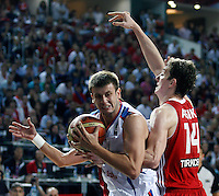 Novica VELICKOVIC (Serbia)  passes Omer ASIK (Turkey) during the semi-final World championship basketball match against Turkey in Istanbul, Serbia-Turkey, Turkey on Saturday, Sep. 11, 2010. (Novak Djurovic/Starsportphoto.com) .