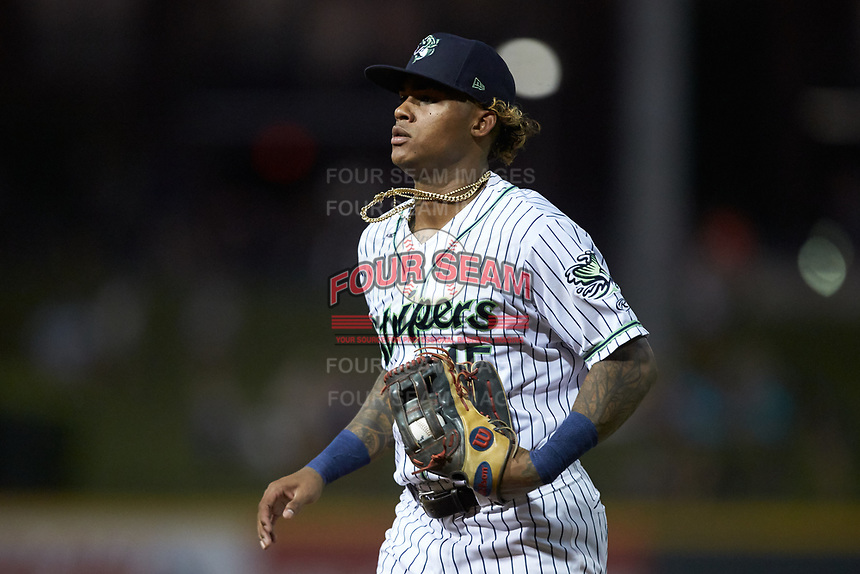 Gwinnett Stripers right fielder Cristian Pache (15) jogs off the field between innings of the game against the Scranton/Wilkes-Barre RailRiders at Coolray Field on August 17, 2019 in Lawrenceville, Georgia. The Stripers defeated the RailRiders 8-7 in eleven innings. (Brian Westerholt/Four Seam Images)