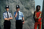 Stonehenge summer solstice, black British undercover policeman trying not to look conspicuous! 1970s.