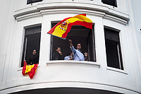 MADRID, SPAIN – MAY 04: A family waves the Spanish flag in front of the PP headquarters as a sign of victory on 4 May in Madrid, Spain. (Photo by Joan Amengual / VIEWpress via Getty Images)