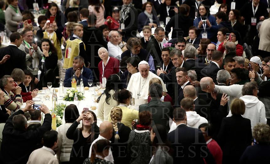 Papa Francesco parla al suo arrivo in Aula Paolo VI in Vaticano. 19 novembre 2017.<br /> Sua Santità ha offerto un pranzo ai bisognosi (senzatetto, migranti, disoccupati) dopo aver celebrato una Messa in occasione della prima Giornata Mondiale dei Poveri.<br /> Pope Francis speaks as he arrives for a lunch in Paul VI Hall  at the Vatican on Sunday, November 19, 2017. <br /> Pope Francis is offering several hundred poor people (homeless, migrants, unemployed) a lunch after celebrating a special mass to mark the new World Day of the Poor.<br /> UPDATE IMAGES PRESS/Isabella Bonotto<br /> <br /> STRICTLY ONLY FOR EDITORIAL USE
