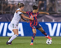 EAST HARTFORD, CT - JULY 1: Jocelyn Orejel #4 of Mexico defends Carli Lloyd #10 of the USWNT during a game between Mexico and USWNT at Rentschler Field on July 1, 2021 in East Hartford, Connecticut.