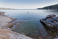 A paddleboarder off Kerasia beach in Corfu, Greece. Thursday 03 September 2020