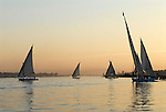 Feluccas on the River Nile at Luxor at sunset.The town of Luxor occupies the eastern part of a great city of antiquity which the ancient Egytians called Waset and the Greeks named Thebes.
