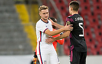 GUADALAJARA, MEXICO - MARCH 24: Djordje Mihailovic #8 of the United States and Johan Vasquez #5 of Mexico congratulate each other after the match during a game between Mexico and USMNT U-23 at Estadio Jalisco on March 24, 2021 in Guadalajara, Mexico.