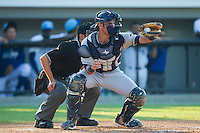Princeton Rays catcher Nick Ciuffo (14) reaches for a high pitch in front of home plate umpire Reid Joyner during the game against the Burlington Royals at Burlington Athletic Park on July 11, 2014 in Burlington, North Carolina.  The Rays defeated the Royals 5-3.  (Brian Westerholt/Four Seam Images)