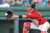 Catcher Austin Rei (13) of the Greenville Drive in a game against the Greensboro Grasshoppers on Thursday, July 14, 2016, at Fluor Field at the West End in Greenville, South Carolina. Greenville won, 3-1. (Tom Priddy/Four Seam Images)