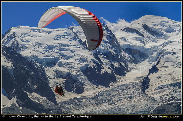 Chamonix, France.  <br /> Paragliders were regularly launching right in front of me, so I composed a tight image with Mt Blanc filling the frame. Then a little patience as I waited for the subject to pass by. I used a 1/2000 of a second shutter speed and f5.4, to freeze the action and minimize the effects of camera movement.  Le Brevent Telepherique mid-station.