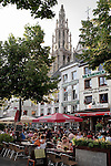 Belgium, Antwerp: cafe scene in the Groenplats with the Cathedral tower behind