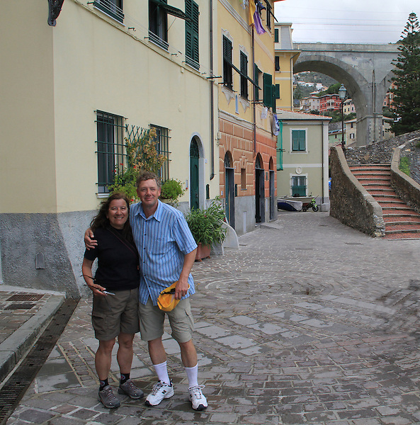 Italy, Mediterranean Coast. <br /> As a photographer, I get the job of asking strangers to take our photo. Photo is internationally understood, picture is not. Compose your photo beforehand along with any camera adjustments, so it goes smoothly. Oh ya, alert your fellow travel companions.<br /> John and Beth in Bogliasco near Genoa, a lovely find.