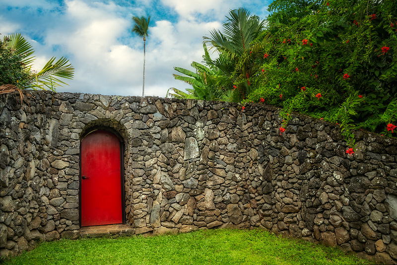 Red door in rock wall. Maui, Hawaii