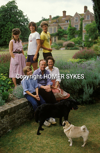 Sir George (1934- 2014) and Lady Mary (1937-2020) Christie and family, the owners of Glyndebourne Opera House, Lewes Sussex England circa 1975.<br /> Left to right. Children. Louise, Gus, Hector, Ptolemy sitting next to his father. Gus is now running Glyndebourne. Hector is a new age activist and owner of Tapeley Park in Devon.  Louise Flind, (Nee Christie) and Ptolemy both work in the theatre?