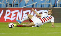 TORONTO, ON - OCTOBER 15: Jordan Morris #11 of the United States slides with the ball during a game between Canada and USMNT at BMO Field on October 15, 2019 in Toronto, Canada.