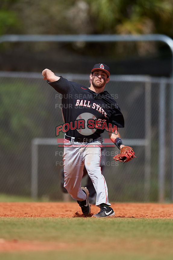 Ball State Cardinals third baseman William Baker (32) throws to first base during a game against the Saint Joseph's Hawks on March 9, 2019 at North Charlotte Regional Park in Port Charlotte, Florida.  Ball State defeated Saint Joseph's 7-5.  (Mike Janes/Four Seam Images)