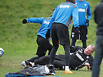 Ally McCoist almost wipes out Ian Black at training