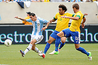 Argentina midfielder Angel Di Maria (7) runs with the ball follow by Brazil defender Marcelo (6) The Argentina National Team defeated Brazil 4-3 at MetLife Stadium, Saturday July 9 , 2012.