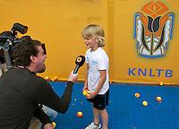 Netherlands, Den Bosch, 18.06.2014. Tennis, Topshelf Open, Kidsday, boy being interviews by TV crew<br /> Photo:Tennisimages/Henk Koster