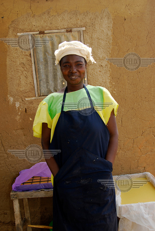 """50 year old Marie Madeleine Dabone Bebane runs a small soap making business. After receiving training from PAMER she now adds to her income by selling specialist soaps containing nut oils and honey, which have therapeutic properties. """"I live entirely from this business and have sent three of my children to university in the capital. Since my husband died I have been the only income earner. I cannot imagine how I would've survived after his death if I'd not had the training and support from PAMER to start my own business. I would have had to sell the house and rely on other relatives."""" Supported by IFAD, the International Fund for Agricultural Development, PAMER (Projet d'Appui aux Micro Entreprises Rurales) provides farmers with training and support to develop micro-enterprises in rural areas of Burkina Faso.."""