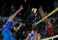 Phil Dalhausser USA sin.<br /> Sean Rosenthal USA in basso<br /> Aleksandrs Samoilovs Lettonia (Latvia)<br /> <br /> in action during the men's final match between Usa and Latvia at the Beach Volleyball World Tour Grand Slam, Foro Italico, Rome, 23 June 2013. USA defeated Latvia 2-0.<br /> UPDATE IMAGES PRESS/Isabella Bonotto