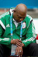 Nigeria manager Stephen Keshi looks at his watch