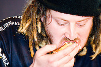 """Jason """"Crazy Legs"""" Conti eats as quickly as possible at the I.F.O.C.E. sanctioned Grilled Cheese Eating Competition, held in New York City on February 1, 2006."""