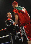 Hari Miles gets some last minute instructions from his trainer Enzo Calzaghe. Hari Miles ( Red with Black stripe ) V Nick Okoth (Black flame shorts).Justin Hugh (Black & Red shorts) V James Tucker (Red & White shorts). , Joe Calzaghe Promotions Boxing Evening .Date: Friday 20/11/2009,  .© Ian Cook IJC Photography, 07599826381, iancook@ijcphotography.co.uk,  www.ijcphotography.co.uk, .