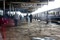 The ghosted figures of fast moving commuters in Nairobi Railways Station.