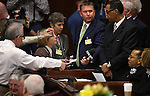 Members of the media surround embattled Nevada Assemblyman Steven Brooks, D-North Las Vegas, seated at right, during the opening day of the 77th Legislative Session in Carson City, Nev. on Monday, Feb. 4, 2013. Brooks, who was arrested Jan. 19 and accused of threatening incoming Democratic Speaker Marilyn Kirkpatrick, decline to talk to the media. (AP Photo/Cathleen Allison)