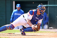 Buffalo Bisons catcher Rob Johnson #46 dives to attempt and tag a base runner during a game against the Lehigh Valley IronPigs at Coca-Cola Field on April 19, 2012 in Buffalo, New York.  Lehigh Valley defeated Buffalo 8-4.  (Mike Janes/Four Seam Images)