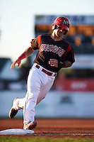 Batavia Muckdogs second baseman Taylor Munden (21) rounds third during a game against the Lowell Spinners on August 12, 2015 at Dwyer Stadium in Batavia, New York.  Batavia defeated Lowell 6-4.  (Mike Janes/Four Seam Images)
