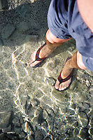 Looking down at feet in water<br />