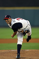 Houston Astros pitcher Andy Pettitte (37) follows through on his pitch during his second rehab start with the Round Rock Express of the Texas League on June 23, 2004 at the Dell Diamond in Round Rock, Texas. (Andrew Woolley/Four Seam Images)
