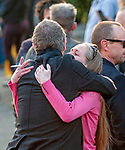 Mourners comfort each other after leaving the service at the funeral of the late Prodigy singer Keith Flint at St Marys Church in Bocking,  Essex today.