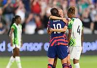 AUSTIN, TX - JUNE 16: Christen Press #23 of the United States celebrates her goal with Carli Lloyd #10 during a game between Nigeria and USWNT at Q2 Stadium on June 16, 2021 in Austin, Texas.