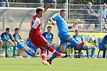 Mirco Born (Nr.38, FC Astoria Walldorf) versucht den Ball zu klaeren  beim Spiel, FC Astoria Walldorf - SC Freiburg II.<br /> <br /> Foto © PIX-Sportfotos *** Foto ist honorarpflichtig! *** Auf Anfrage in hoeherer Qualitaet/Aufloesung. Belegexemplar erbeten. Veroeffentlichung ausschliesslich fuer journalistisch-publizistische Zwecke. For editorial use only. DFL regulations prohibit any use of photographs as image sequences and/or quasi-video.