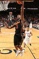 Jan. 27, 2011; Charlottesville, VA, USA; Maryland Terrapins guard Adrian Bowie (1) shoots in front of Virginia Cavaliers guard Jontel Evans (1) during the game at the John Paul Jones Arena. Maryland won 66-42. Mandatory Credit: Andrew Shurtleff