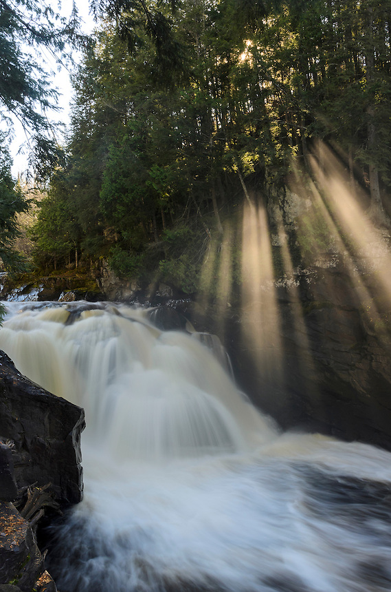 Heavenly beams of sunlight shining through the trees and mist of Sturgeon Falls. Sturgeon River Gorge Wilderness