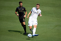 LOS ANGELES, CA - AUGUST 22: Nicholas DePuy #20 of the Los Angeles Galaxy passes off the ball during a game between Los Angeles Galaxy and Los Angeles FC at Banc of California Stadium on August 22, 2020 in Los Angeles, California.