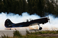 Yak-50 about taking off in formation with other members of his team using smoke. Norway