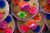 Straw hats adorned with colourful plastic flowers at the Nishitakanomachi Festival, Shimosuwa, Nagano, Japan, July 27 2008